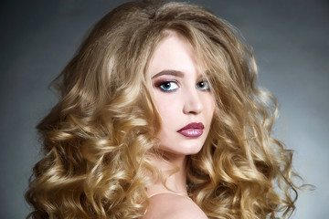 woman with curly hairstyle and make up