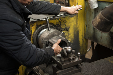 Professional metalworker at the manufacture workshop
