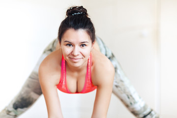Close-up, portrait of a brunette woman practicing yoga, Ardha Padmasana pose, mudra, working out