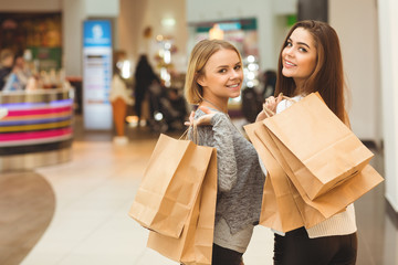 Two attractive females enjoying shopping together