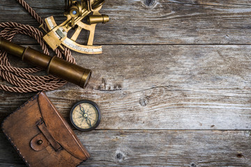 compass,sextant and spyglass on the timber