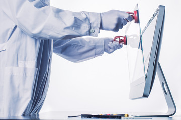Process of computer repair. Engineer in white gloves disassembling computer.