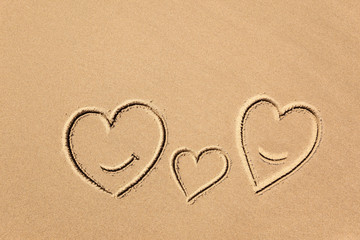 images of hearts in the sand close-up