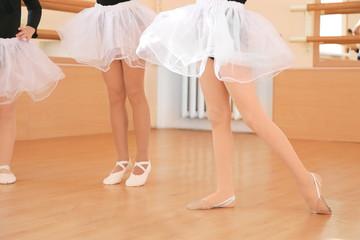 Legs of cute little girls training in dance studio