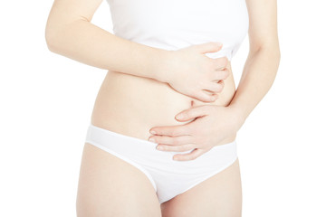 Young woman suffering from abdominal pain isolated on white, clipping path