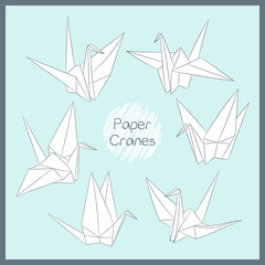 Set of paper cranes. Origami bird figure. Japanese symbol of happiness and joy