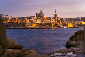 Valletta seafront at sunset with Basilica of Our Lady of Mount Carmel, viewed from Sliema, Malta