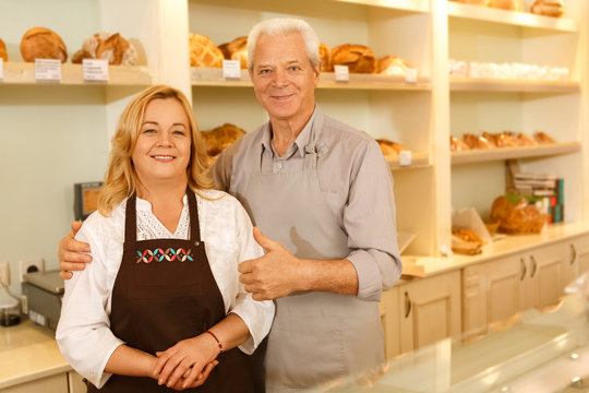 Senior couple running their small family business working at the bakery