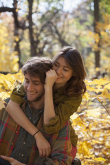 Happy young couple embracing in a park