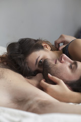 Portrait of a young couple lying down together