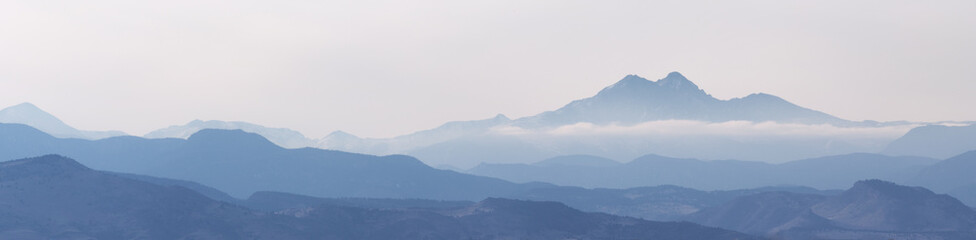 Mountain peaks and valleys shrouded in fog and clouds