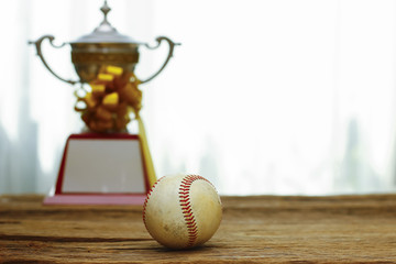 Stock Photo - Baseball with gold Trophy Cup