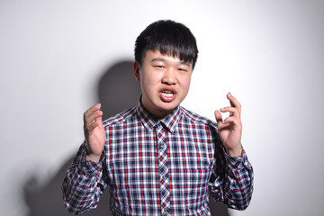 Young Asian business man portrait on white background.