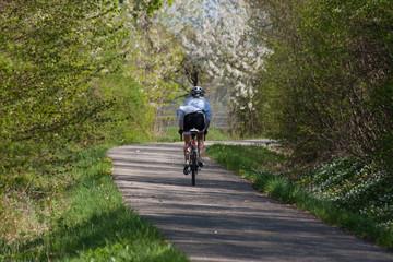 biking in spring blossom