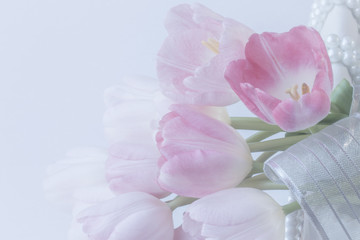 fresh pink tulips on wicker basket