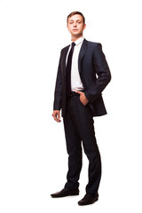 Stylish young man in suit and tie. Business style. Handsome man standing and looking at the camera