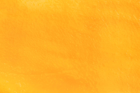 Macro fresh yellow ripe mango texture background with juice for graphic design or commercial use