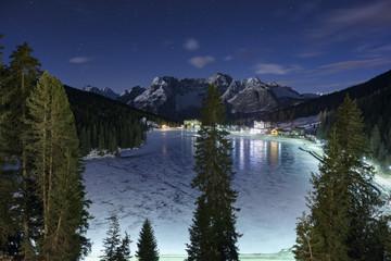 Scenic view of Lake Misurina against mountain range at night