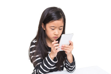 Cute asian girl kid playing smartphone to search video clip on the internet in her free time, isolated on white background (clipping path included)