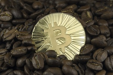 Coffee beans and bitcoin coins laying on white background