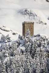 The Belvedere Tower symbol of the Maloja Pass after a heavy snowfall. Engadine. Switzerland. Europe