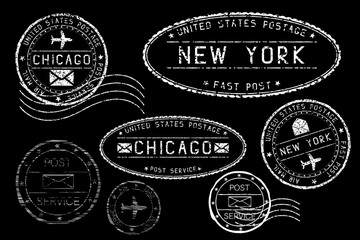 White postmarks on black background. Cities