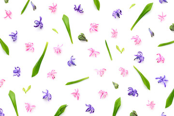 Floral pattern made of hyacinths flowers, green leaves, bud on white background. Top view. Pattern of flowers.