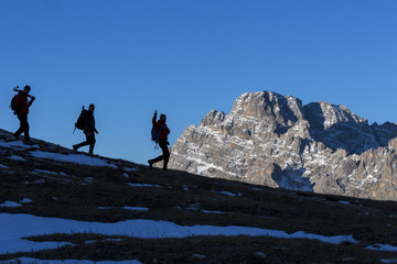 Hikers at sunrise Three Peaks of Lavaredo Dolomites Auronzo of Cadore Veneto Italy Europe
