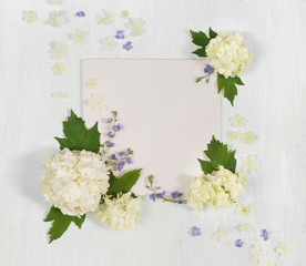 Scrapbook page with white and blue flowers