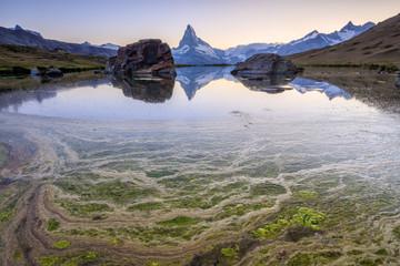 The Matterhorn reflected in Lake Stellisee at dawn Zermatt Pennine Alps Canton of Valais Switzerland Europe