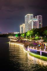 Panoramic view of illuminated Lichun river in the night. Sanya city on Hainan Island of China