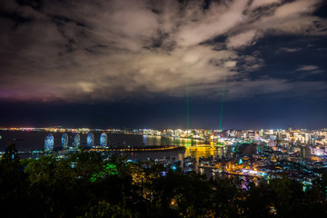 Night view of an artificial Phoenix island and Sanya city illuminated with city lights. View from Luhuitou Park on Hainan Island of China.