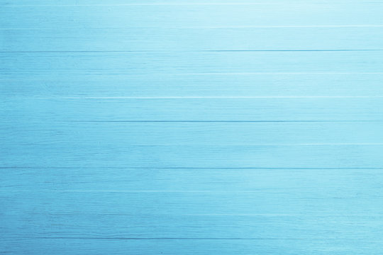 Blue wood background. Painted scraped wooden board. Bright texture or pattern.