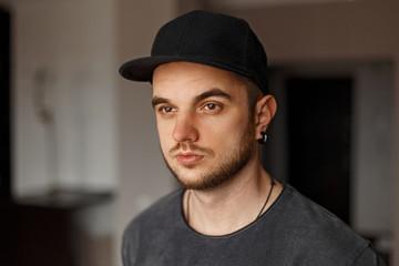Handsome hipster man in a black baseball cap