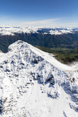 Aerial view of the snowy peaks of the Grignone mountain and Valsassina Lecco Province Lombardy Italy Europe