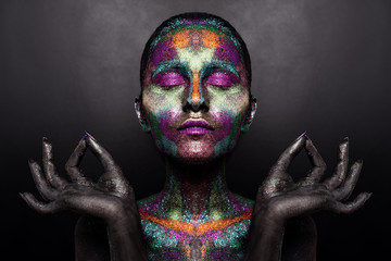 Photo sur Toile Body Paint Young artistic woman in black paint and colourful powder. Glowing dark makeup. Creative body art on the theme of space and stars. Bodypainting project: art, beauty, fashion.