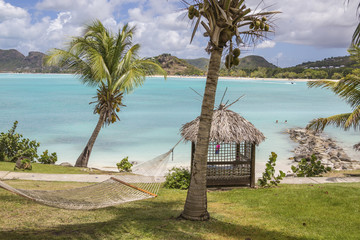 Hammock and palm trees surrounded by the Caribbean Sea Ffryes Beach Sheer Rocks Antigua and Barbuda Leeward Island West Indies