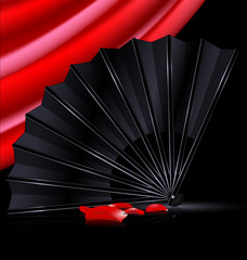 black fan, red drape and and petals