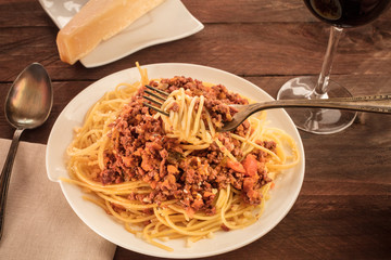 Fork with pasta, meat and tomato sauce, place for text
