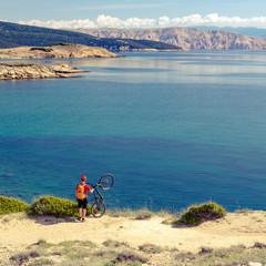 Mountain biker celebrating inspiring view at the sea