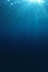 Underwater blue ocean background with sunlight