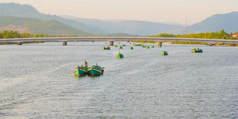 Caravan of fishing boats in Kampot city, Cambodia
