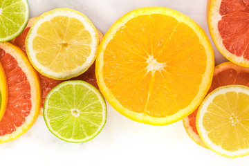 Grapefruit, lime, lemon, and orange slices with copyspace