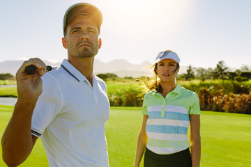Young golfers at golf course together