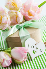 Pink purple tulips and gift box with green ribbon