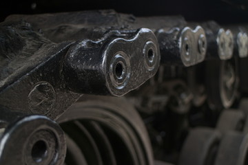 ECU shallow detail of tread links on captured US Army tank on display in Vietnam