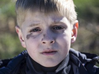boy smeared with soot