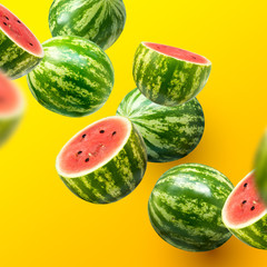 Delicious and juicy sweet watermelons sliced and whole on a summer background.