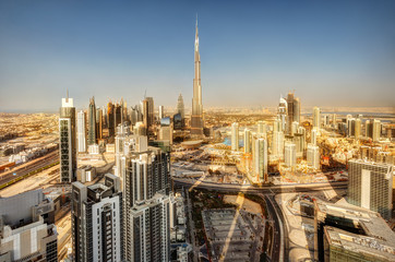 Architecture of a big modern city. Skyscrapers of downtown Dubai, United Arab Emirates. Scenic daytime skyline. Travel and architecture background.