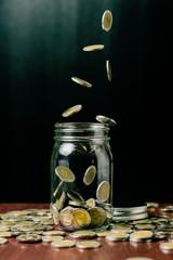 Saving money concept, Money coins fall into bottle.